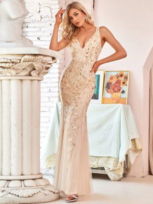 ey7886gd beautiful gold sequin leaf design and tulle long evening gown eternally yours